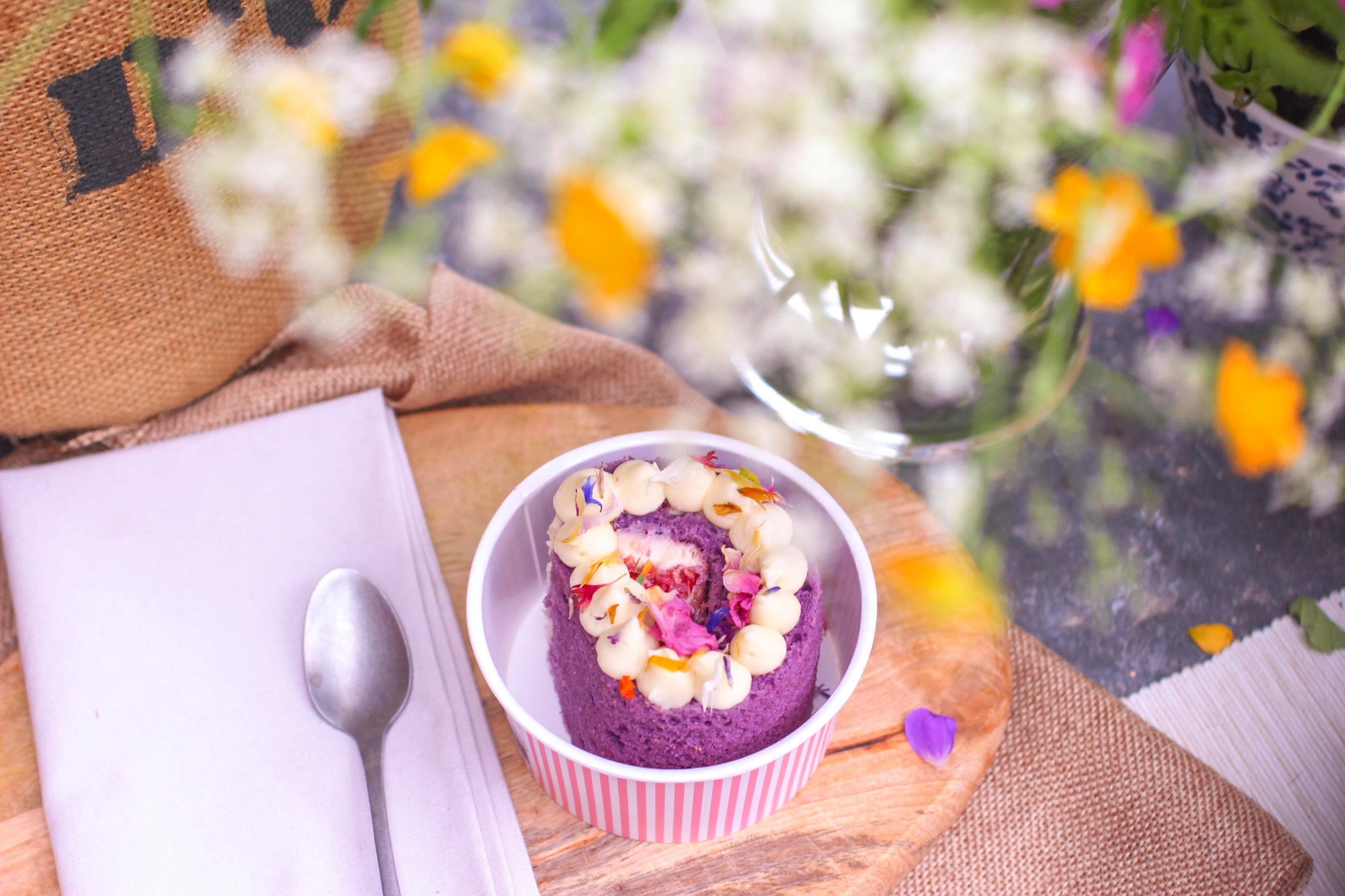 purple and white icing cake on white ramekin bowl