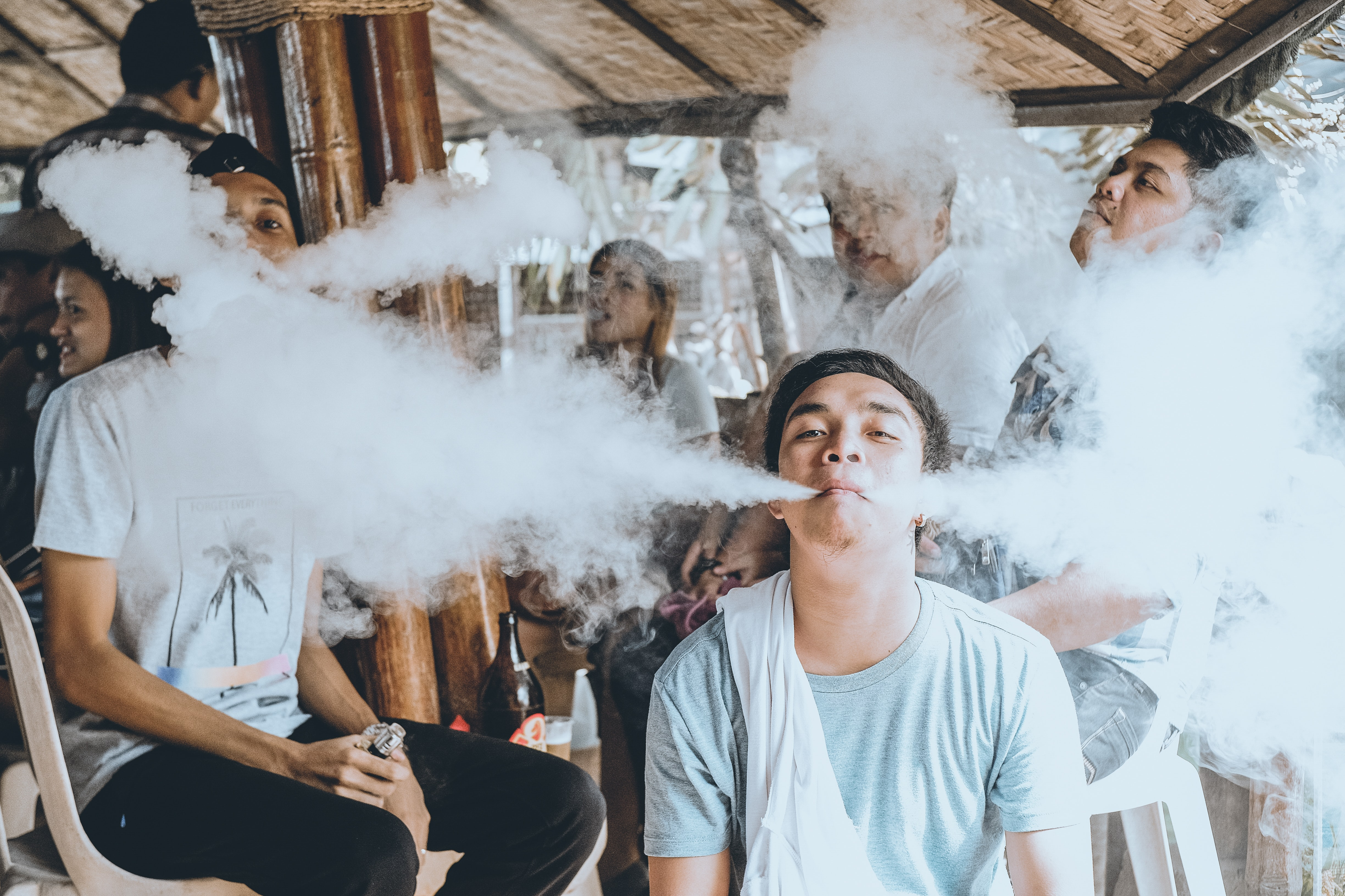 group of people vaping on gazebo