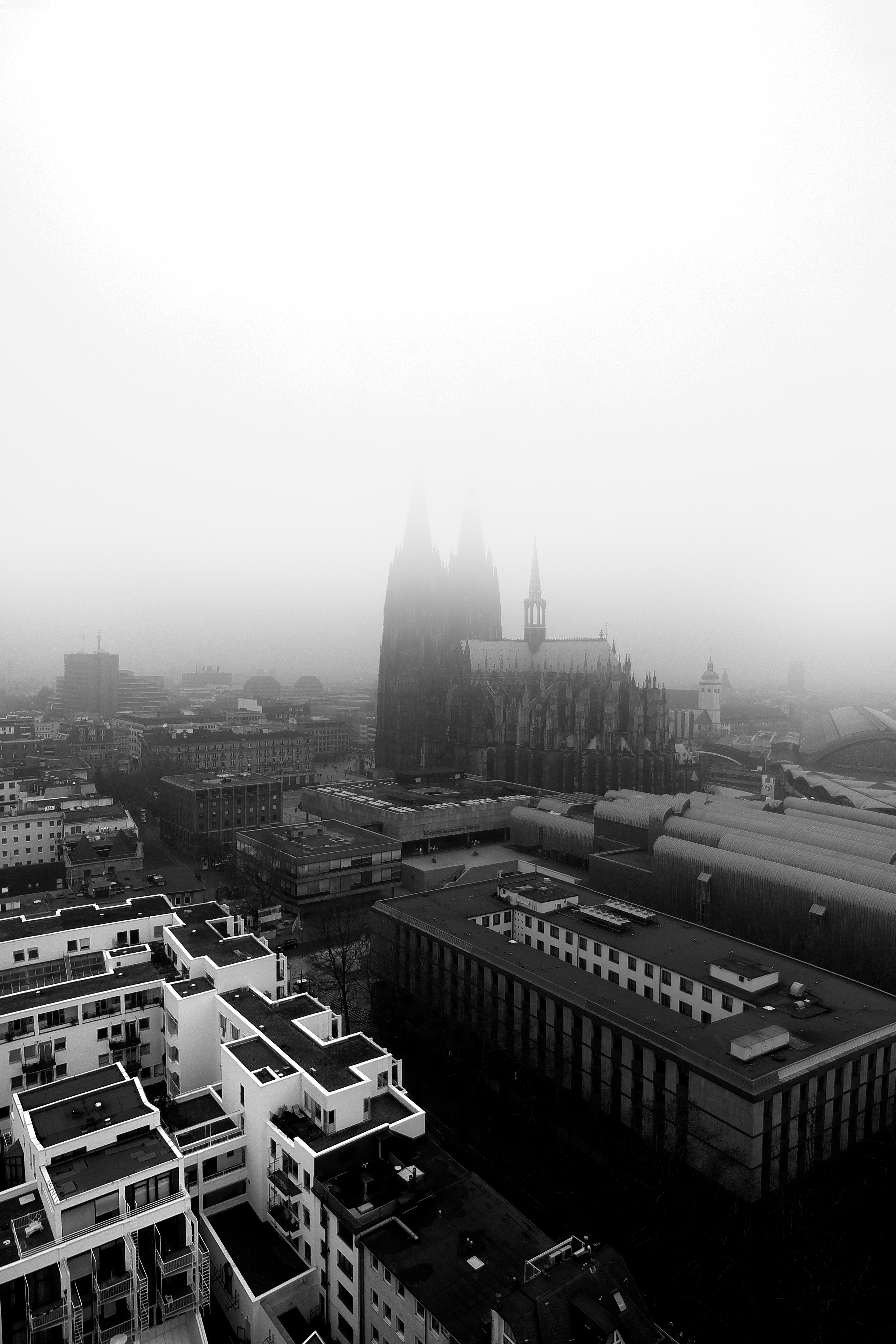 grayscale photography of city buildings