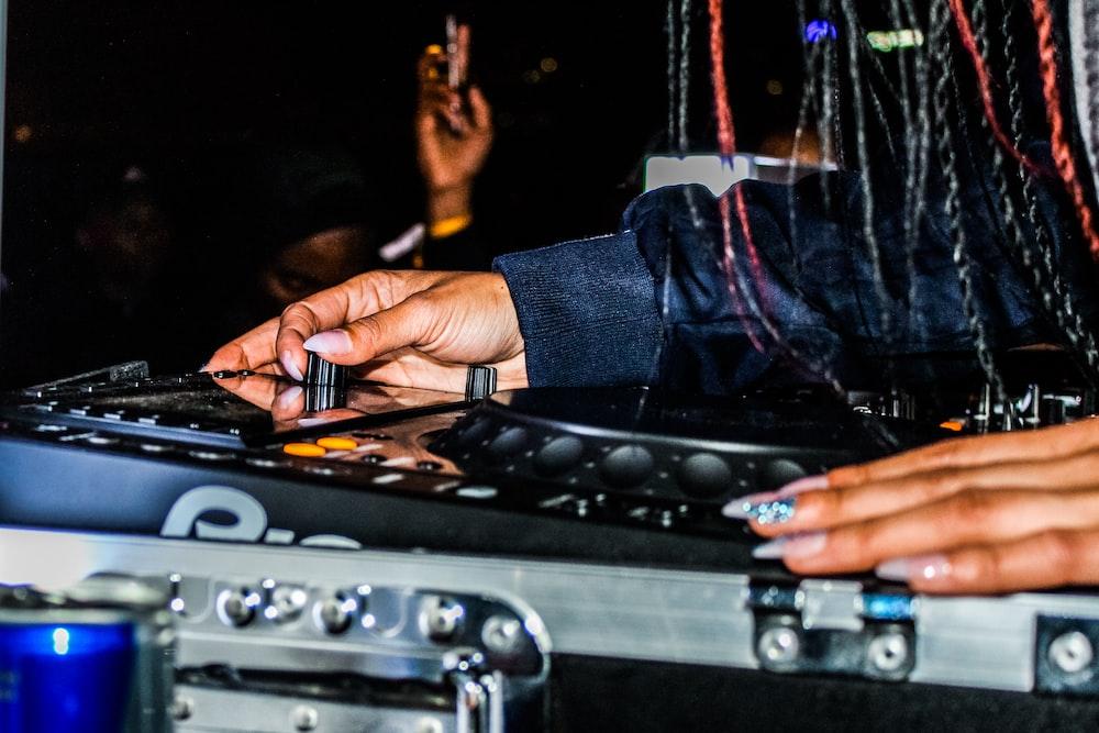 disc jockey controlling DJ controller