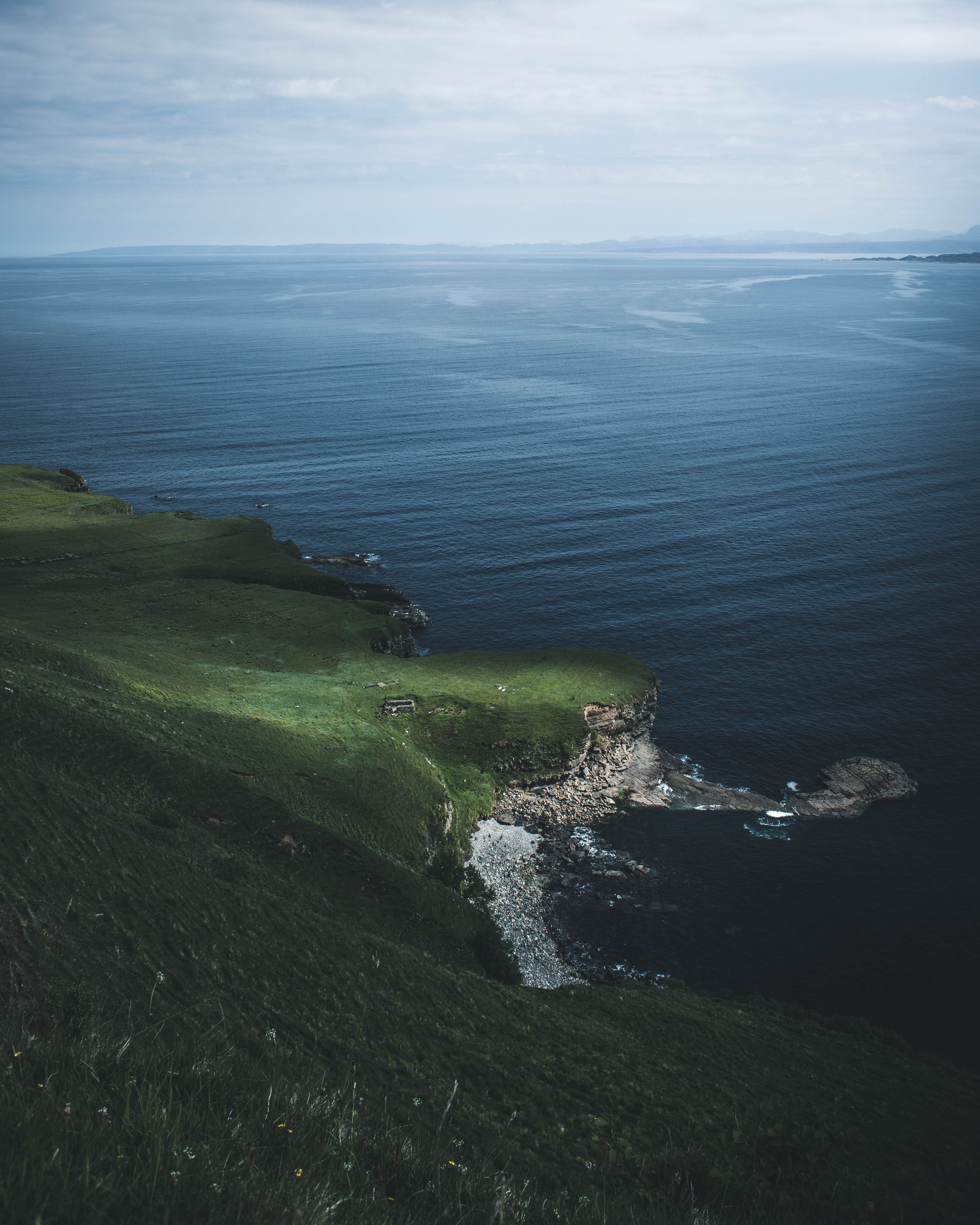 aerial photography of body of water near green land
