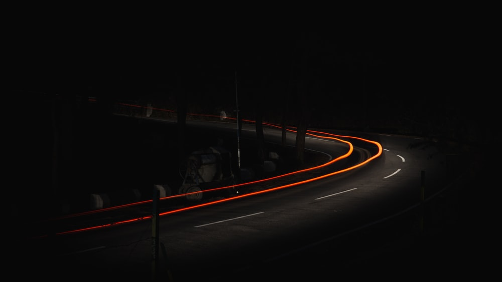 time lapse photo of car on road