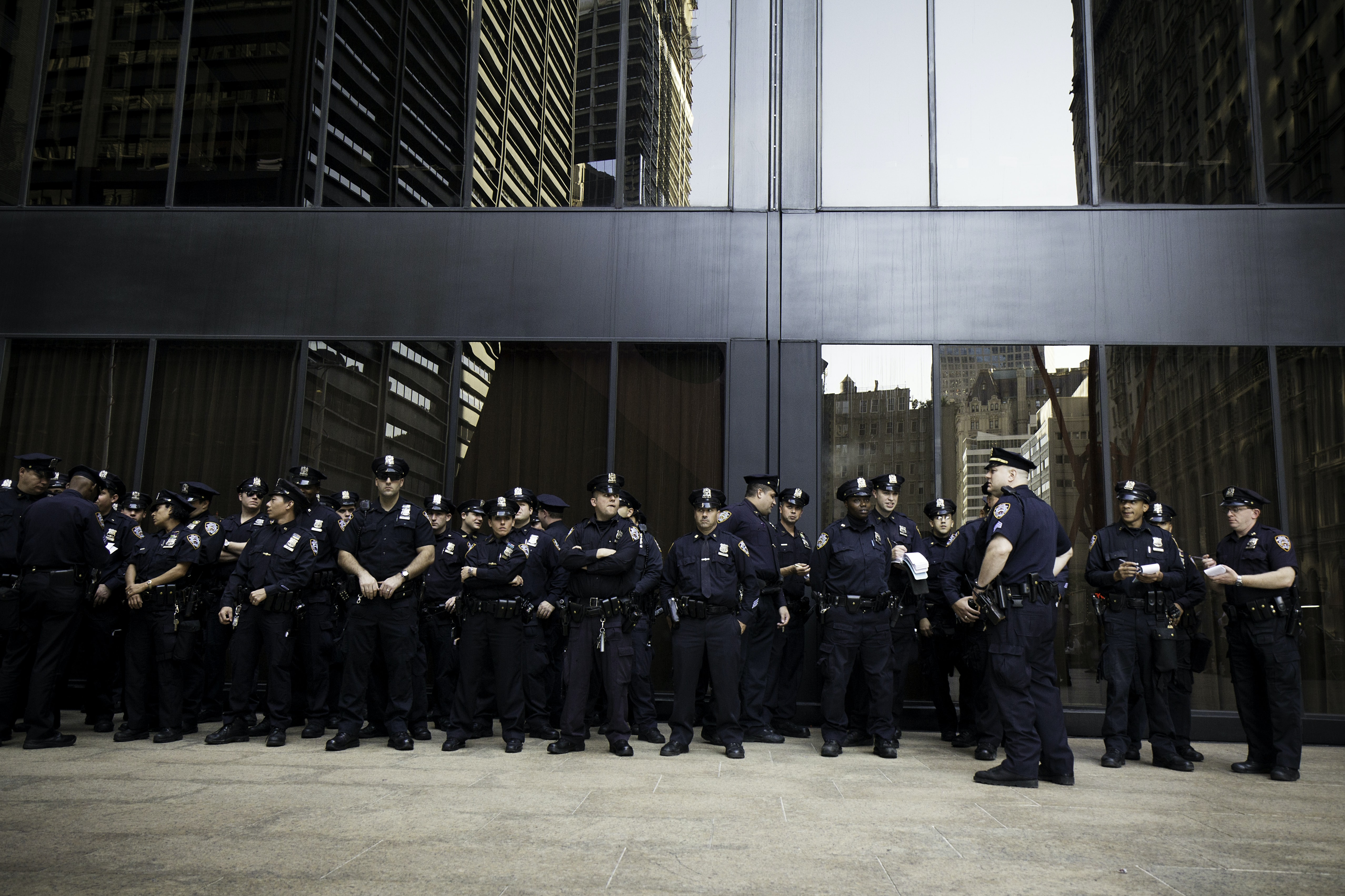 group of police standing near grey building