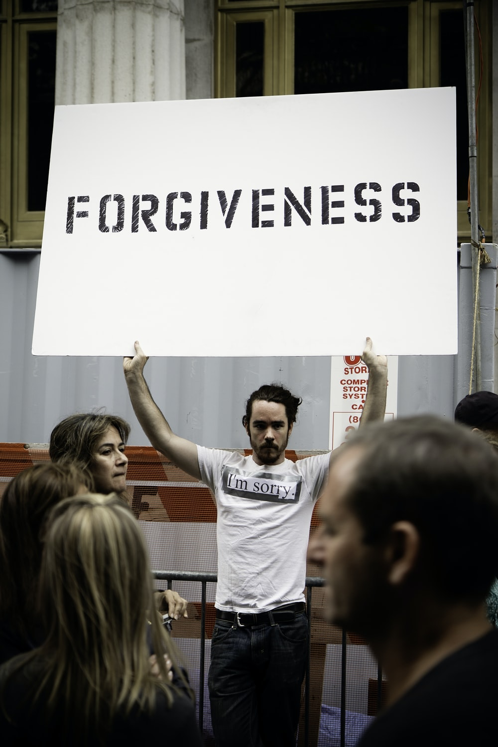 person holding Forgiveness poster