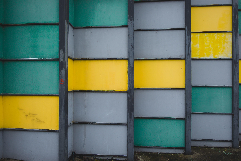 grey, green, and yellow wall closeup photography