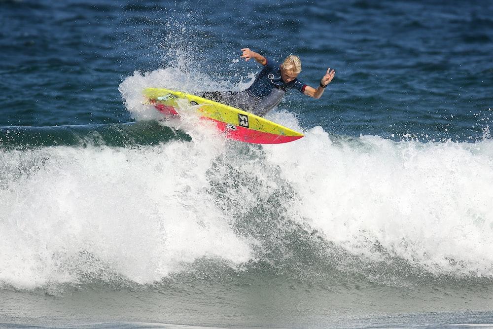 male surfer doing stunts on wave