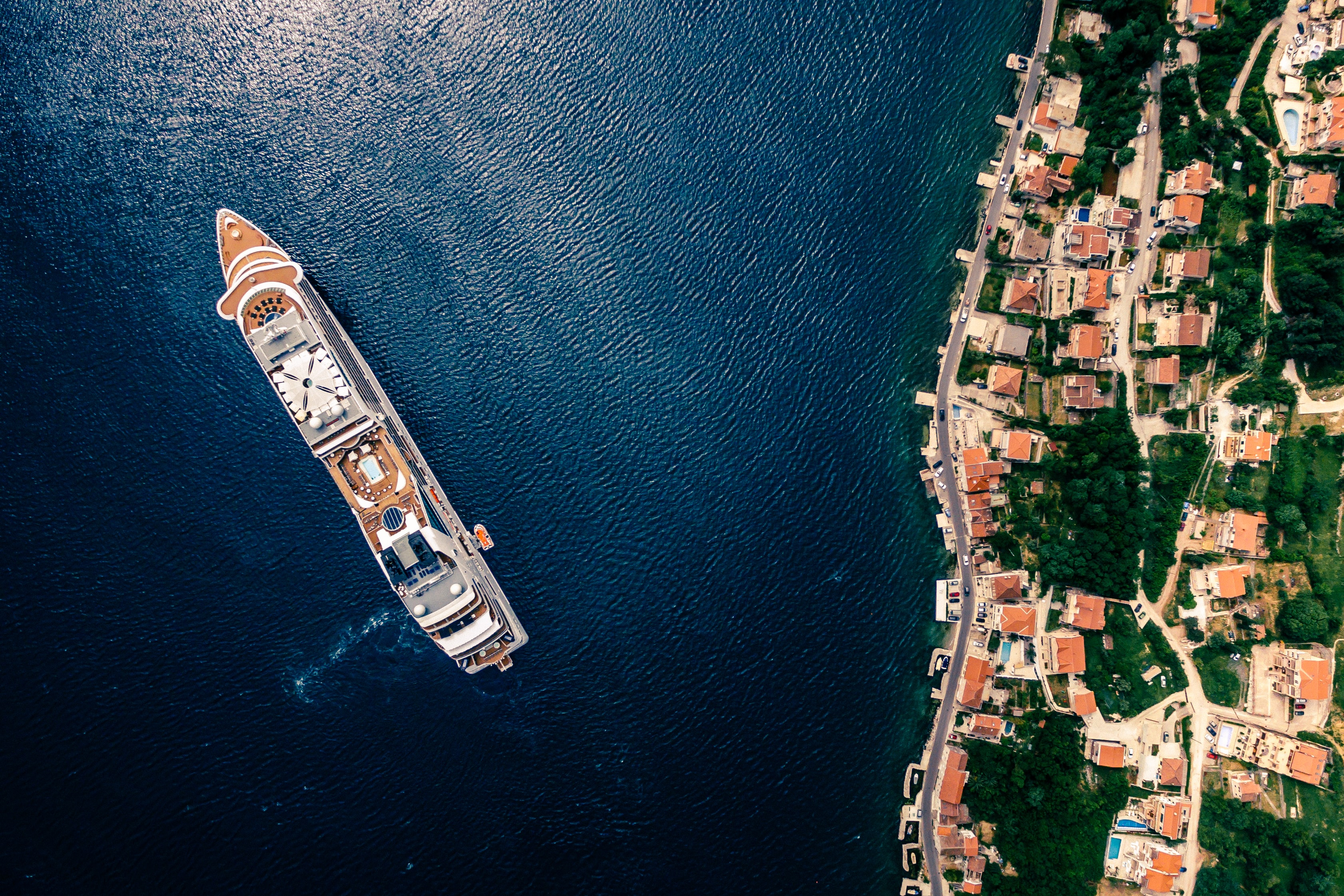 aerial photography of white and brown cruise ship on water