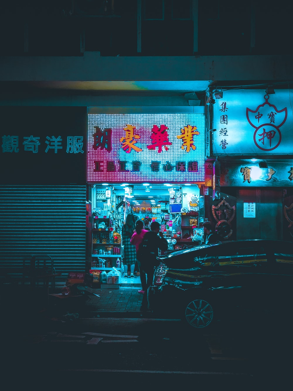 two person standing near storefront during nighttime