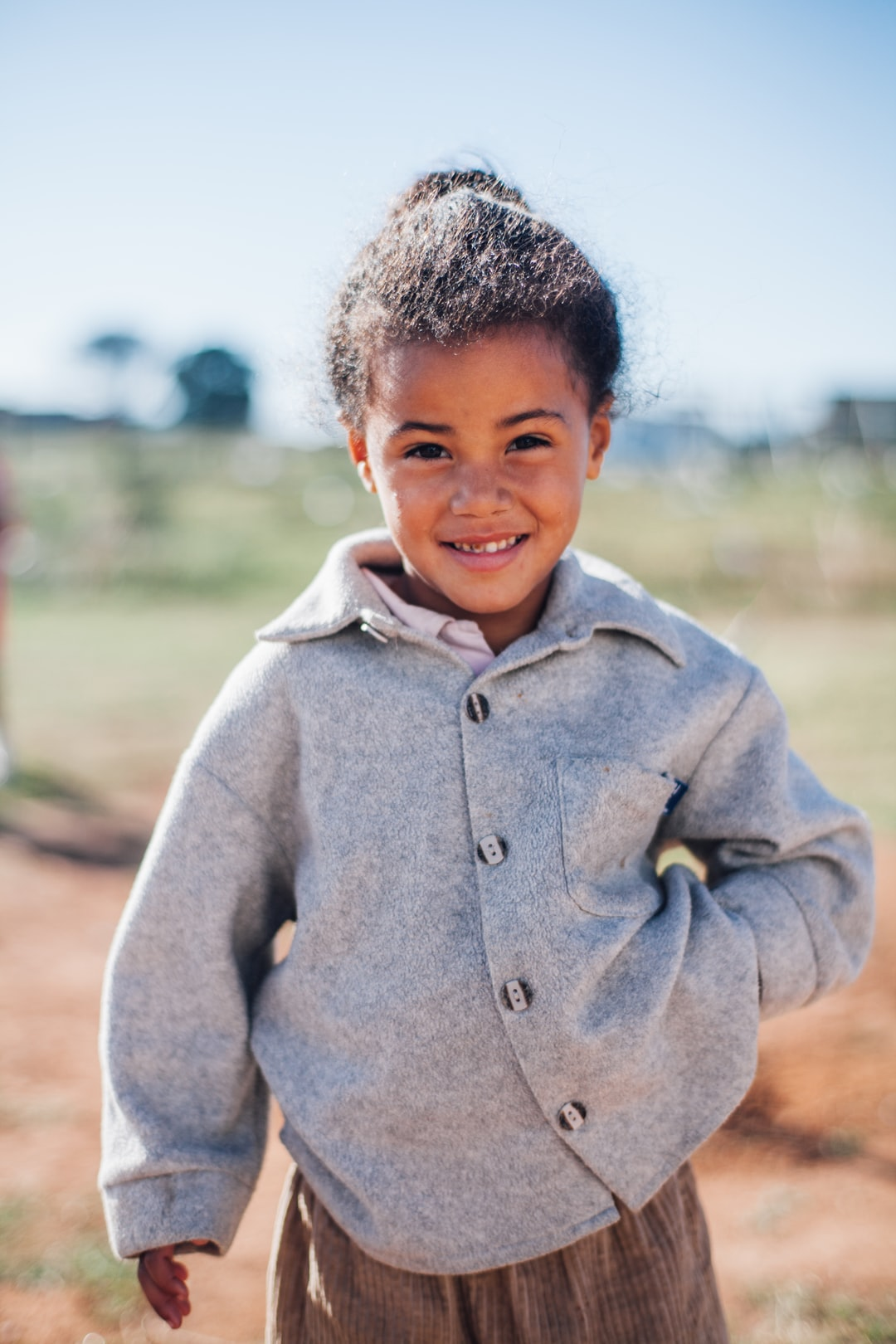 A shy little girl in Africa – she and her family had stood in line for hours for some food that a local church was providing. This was a moment when she stepped away from her mother, looking at me.