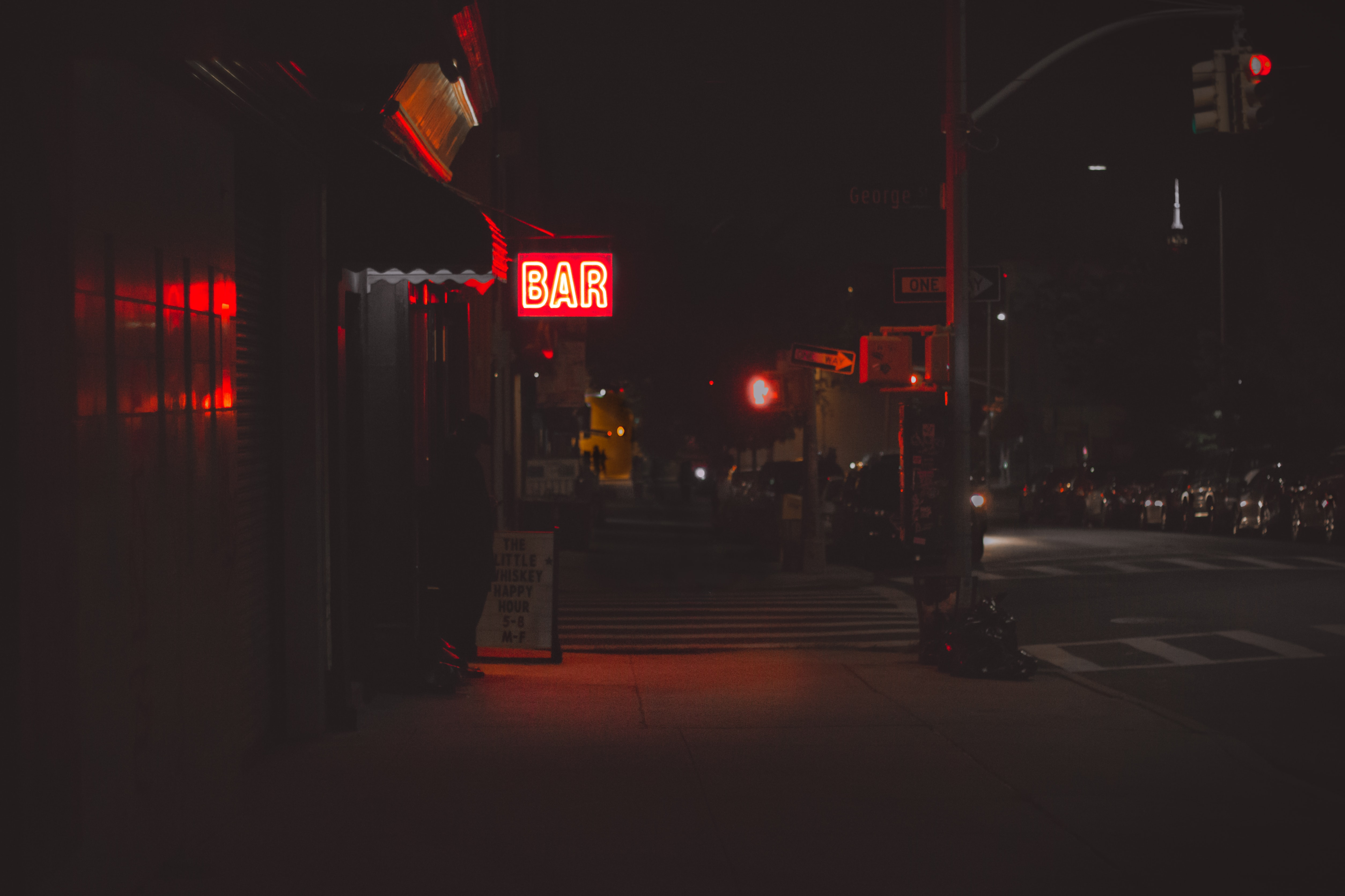 lighted bar signage during nighttime