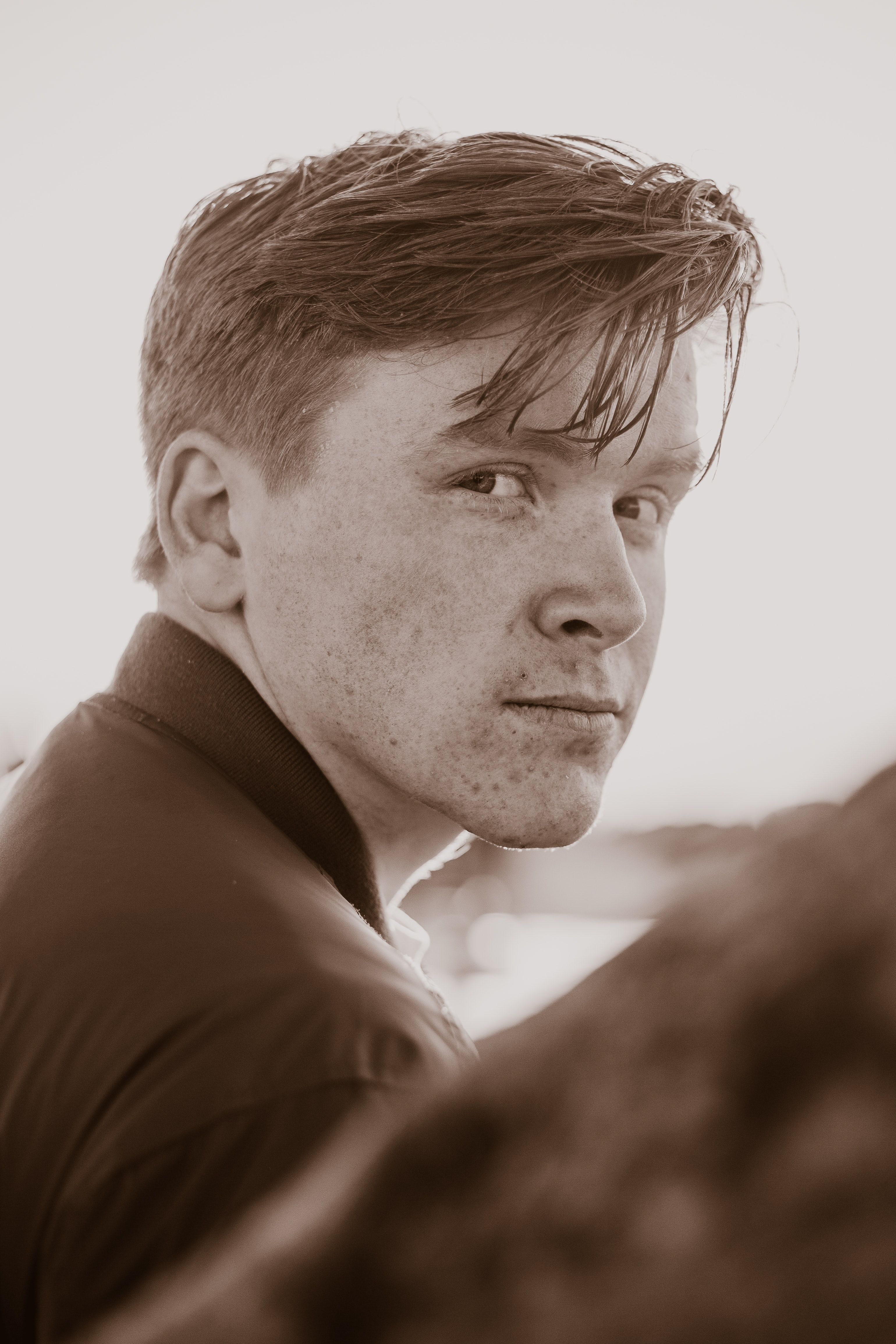 sepia photography of man wearing collared top