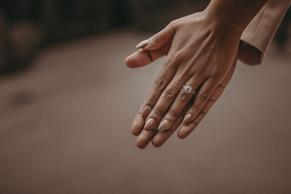 selective focus photography of person's hand