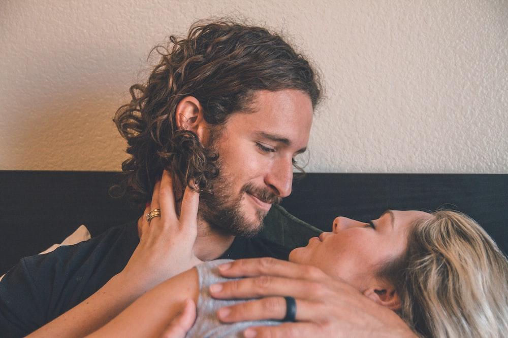 man holding woman