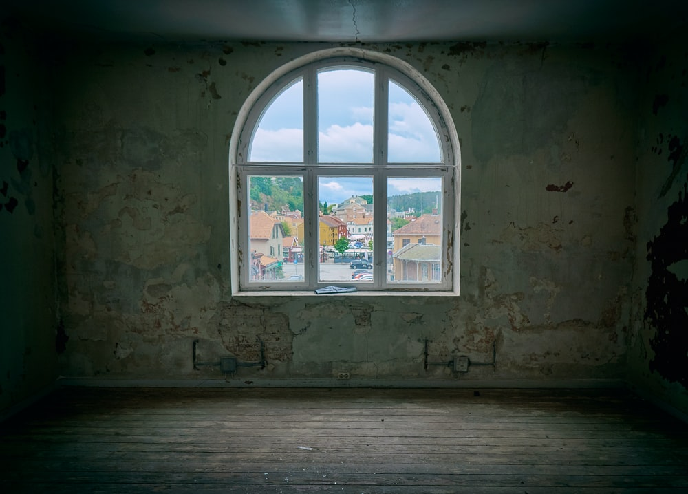 clear glass window inside wood parquet floor
