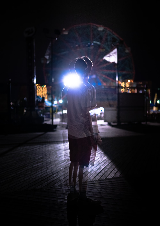 photo of man standing on street