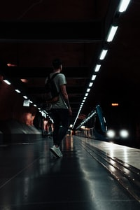 man standing at train station