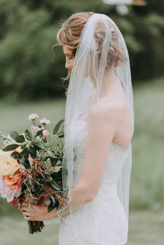 woman wearing white wedding dress with veil