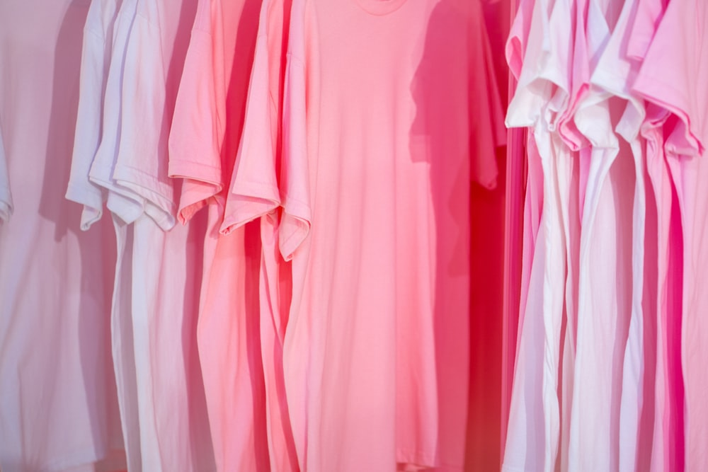 photo of white and pink t-shirts