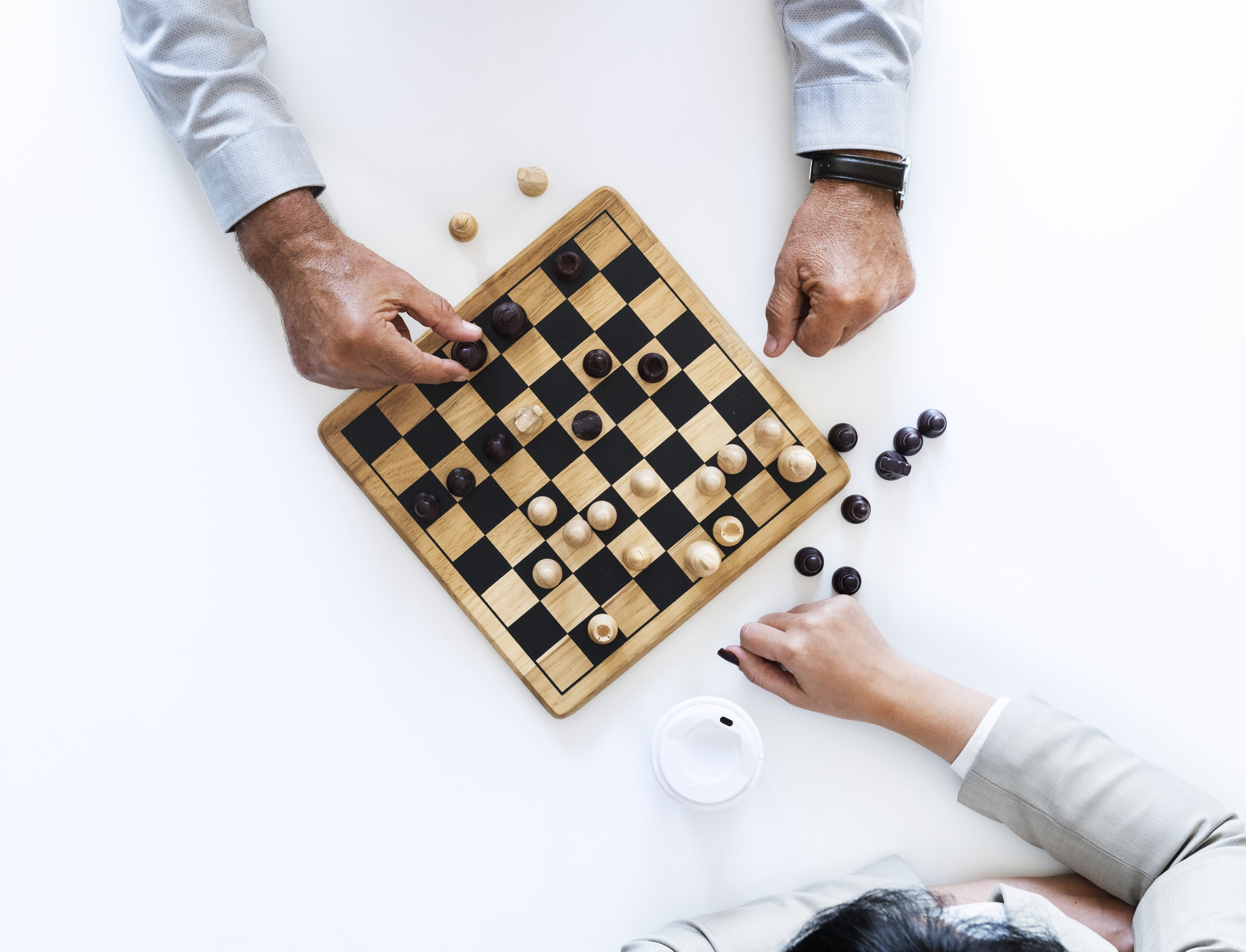 person showing playing chess game