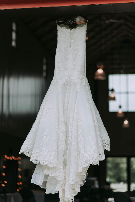 women's white strapless wedding dress hanged on clothes hanger