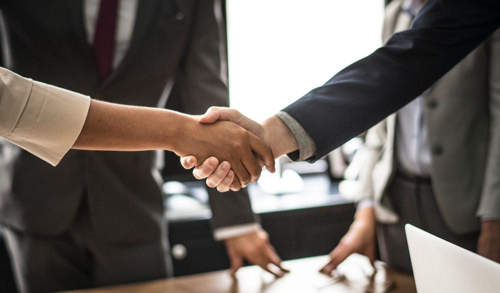 man and woman doing handshake