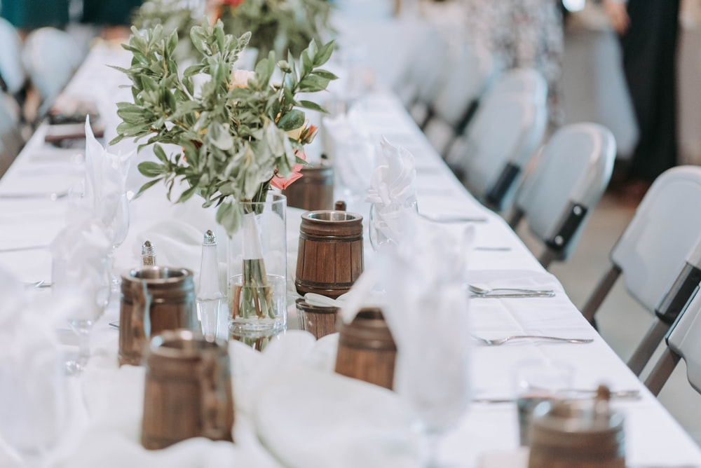 brown wooden containers on white table cloth