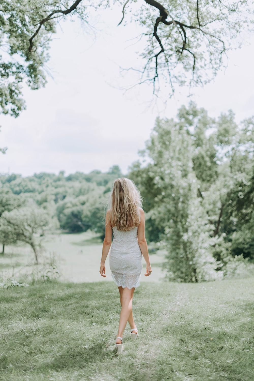 woman in grey dress walking