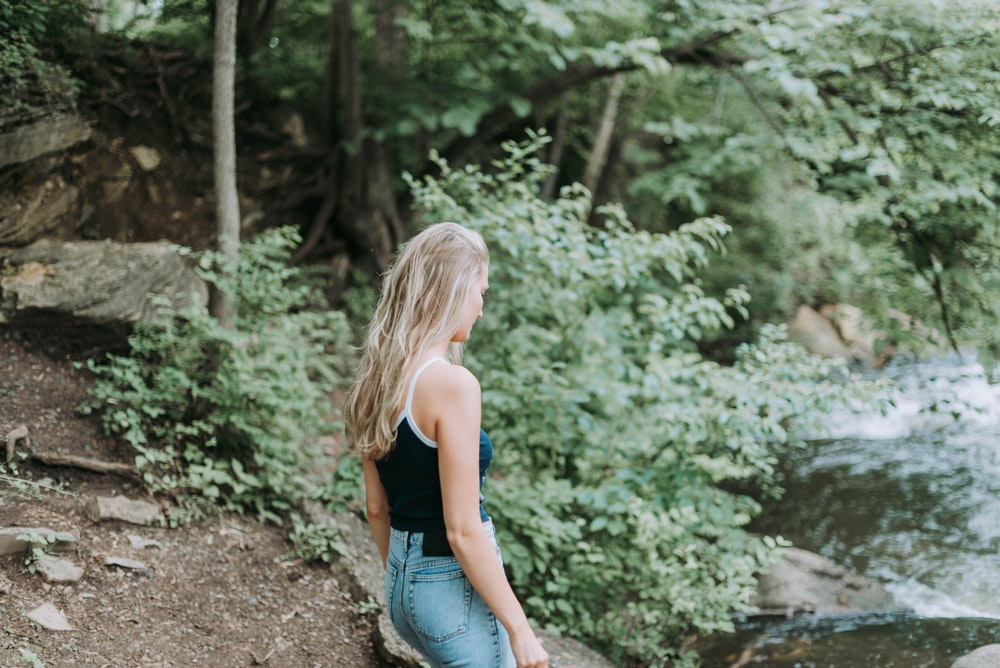 woman standing in front of river