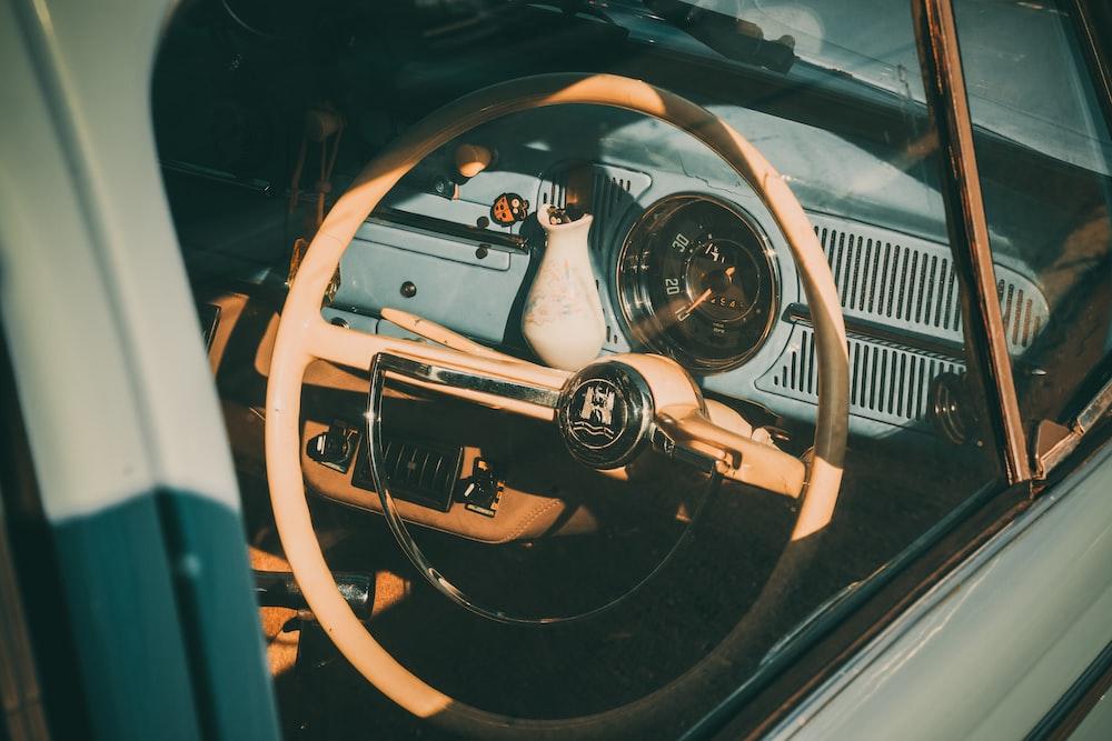 view of classic brown vehicle steering wheel