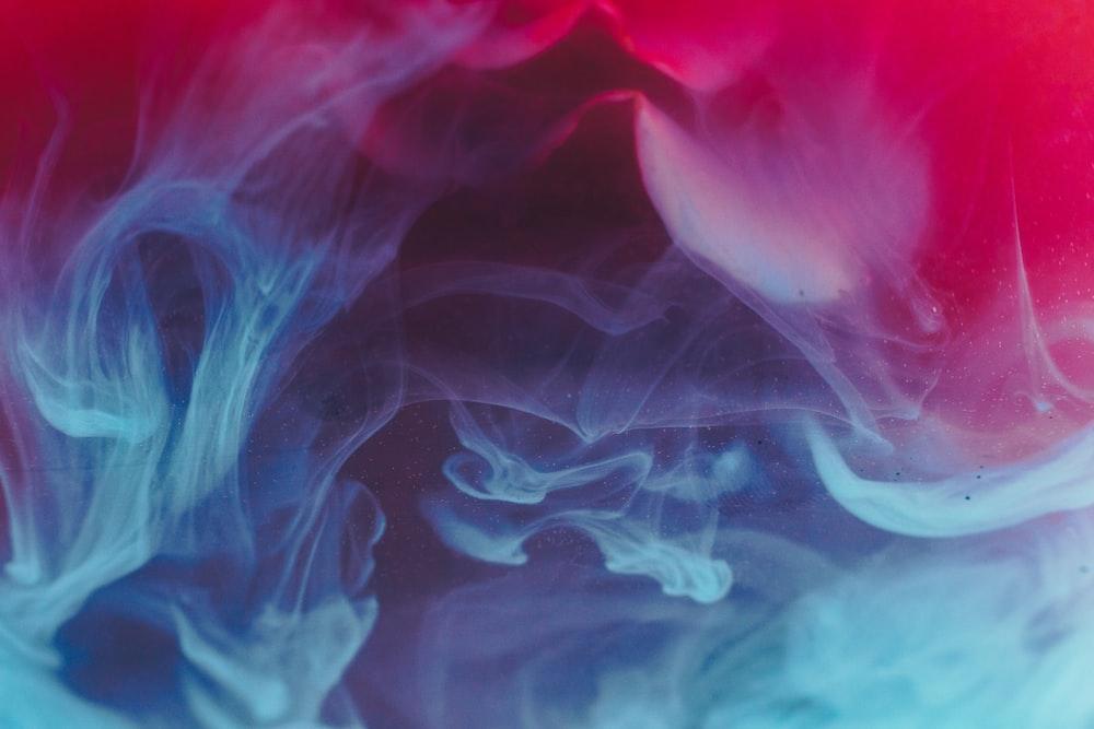 blue, red, and black smoke digital wallpaper