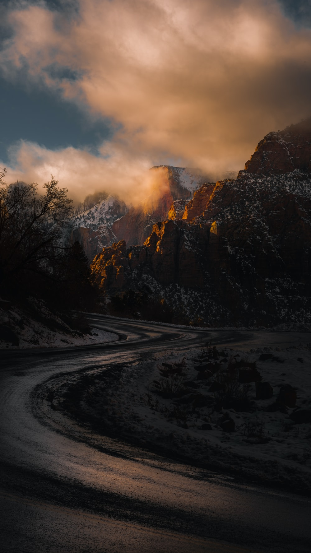 roadway in the middle of rocky mountains