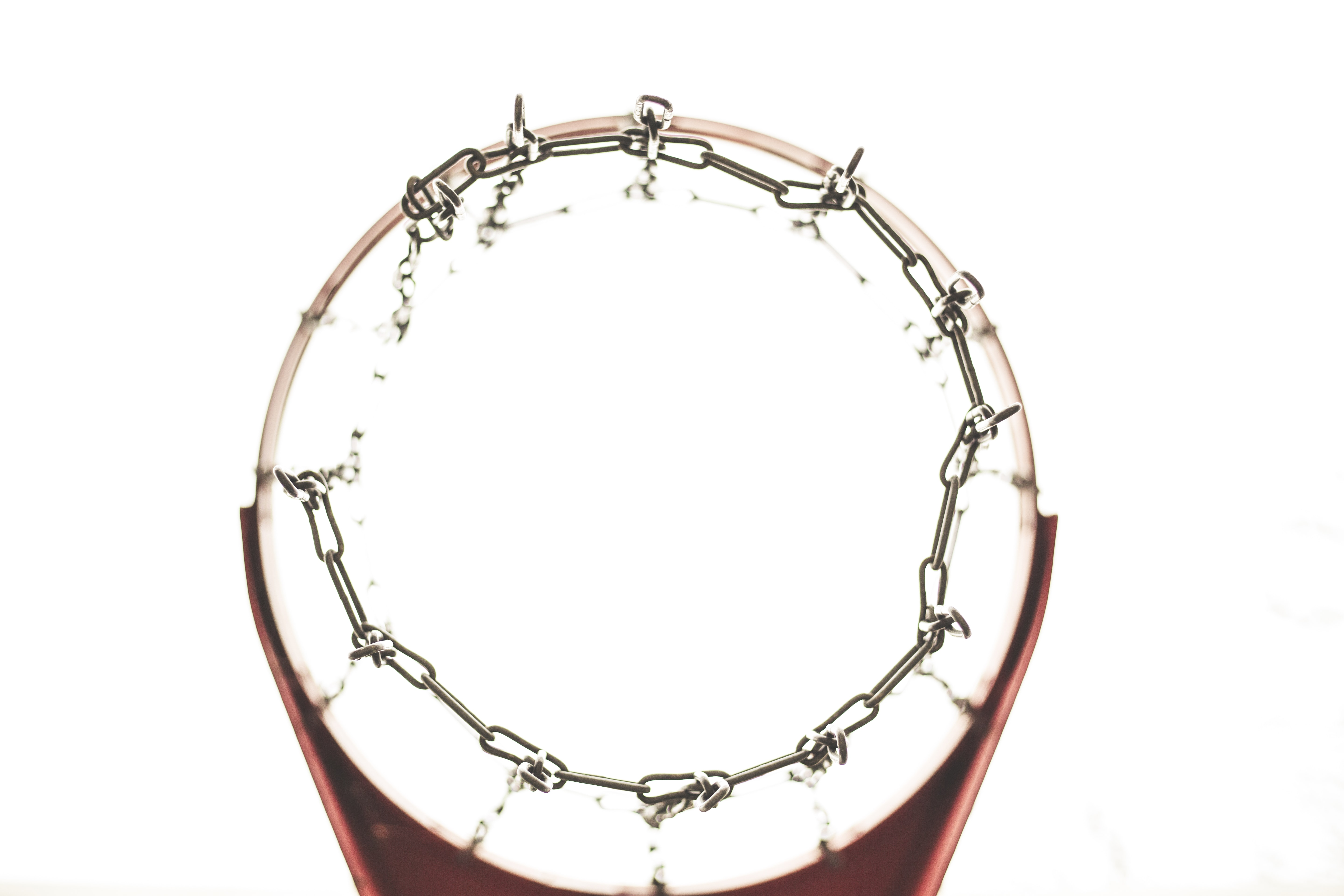 red and gray metal chain net basketball hoop