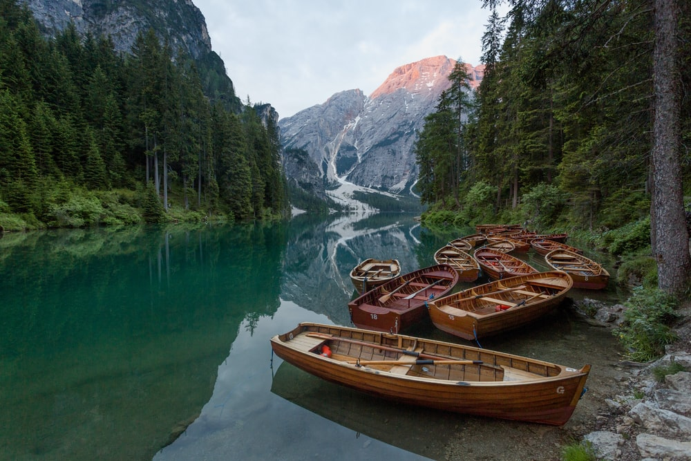 brown wooden jon boat on the body of water