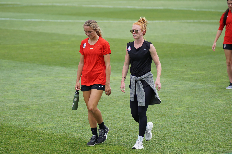 two woman walking beside each other