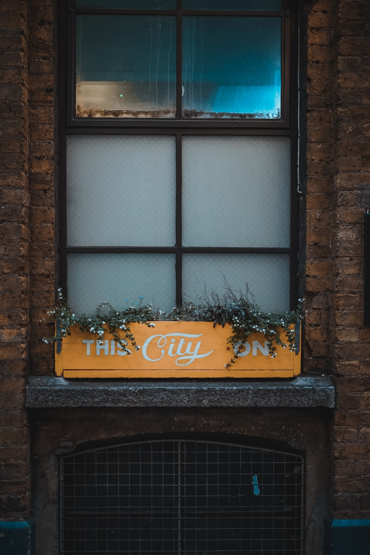 The City sign near window