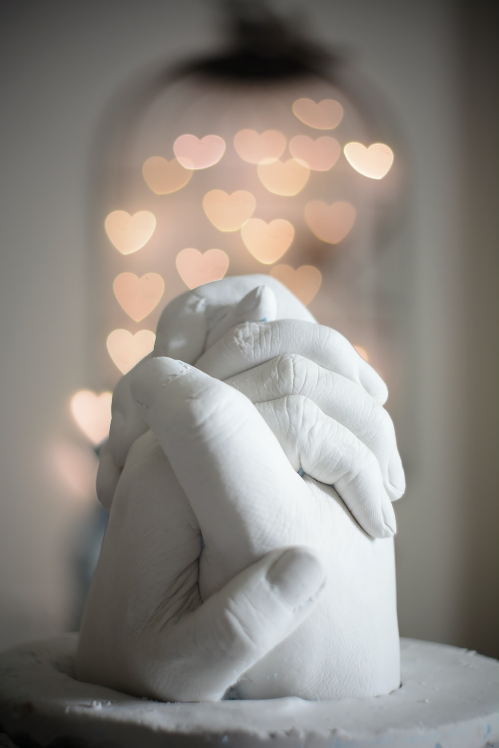 selective focus of holding hands figurine