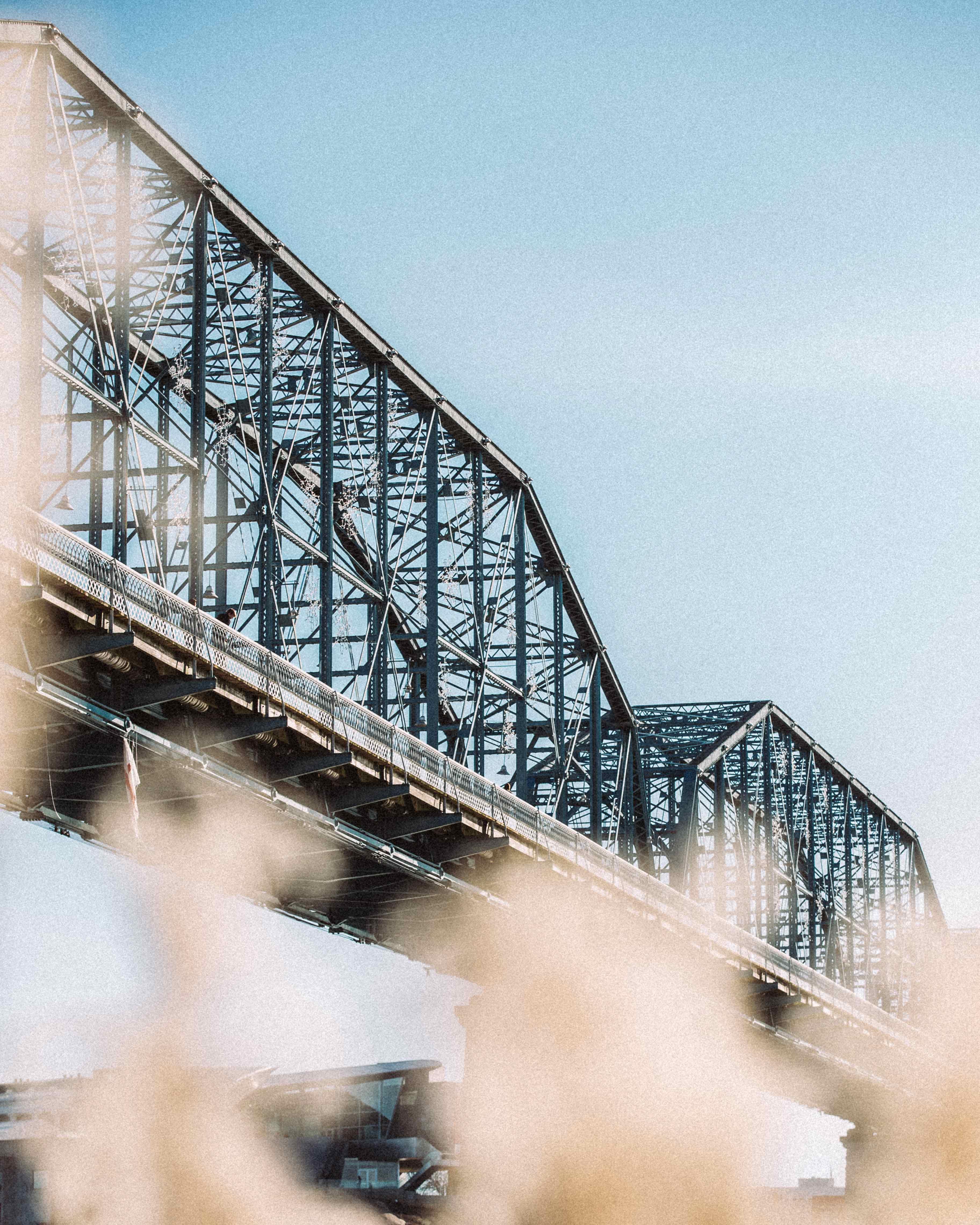 low-angle photography of metal bridge
