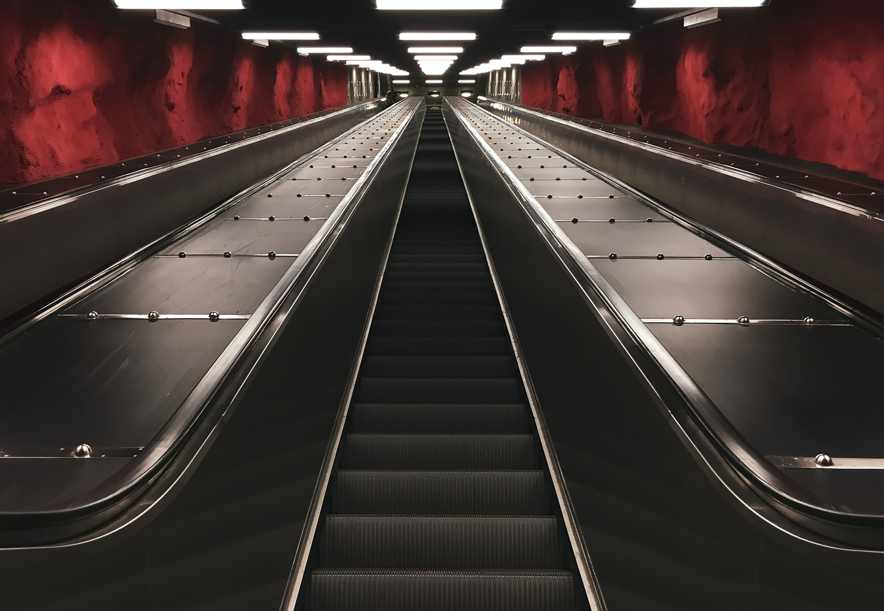 black escalator with no people