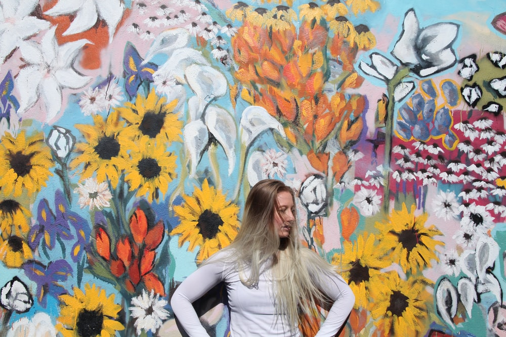 woman standing in front of graffiti