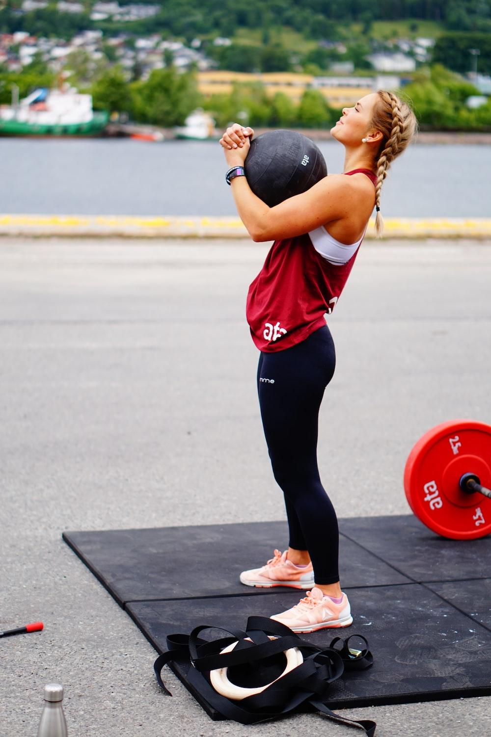 woman doing exercise using medicine ball