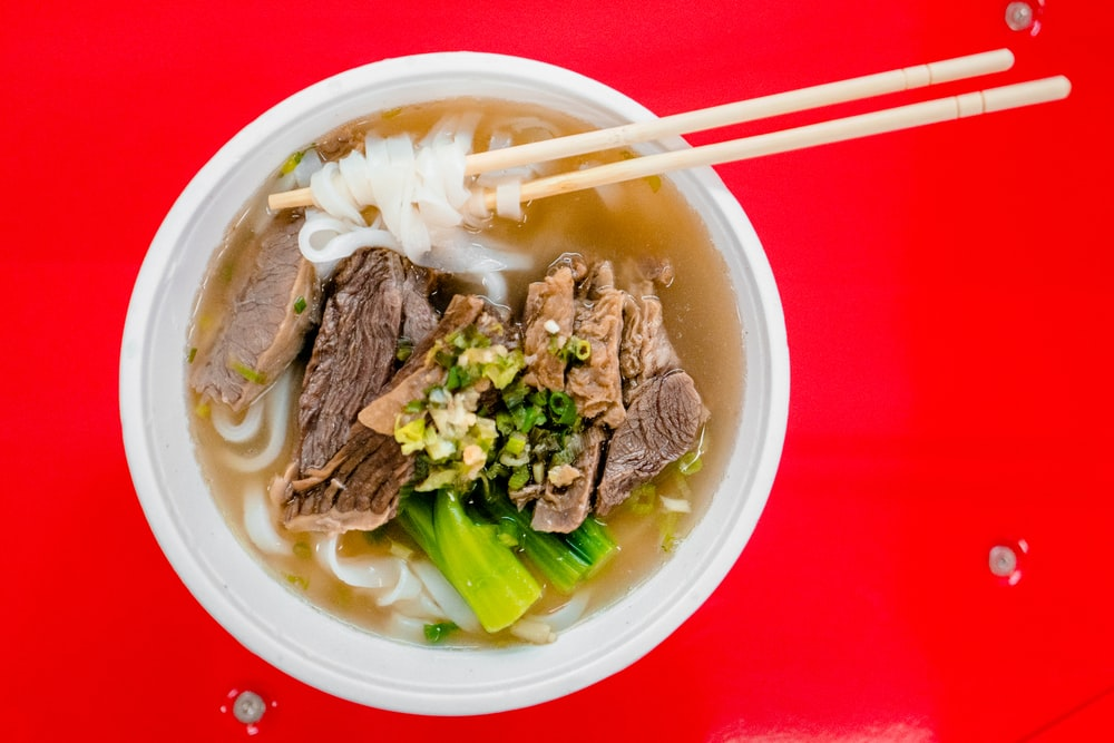 closeup photography of soup with meat