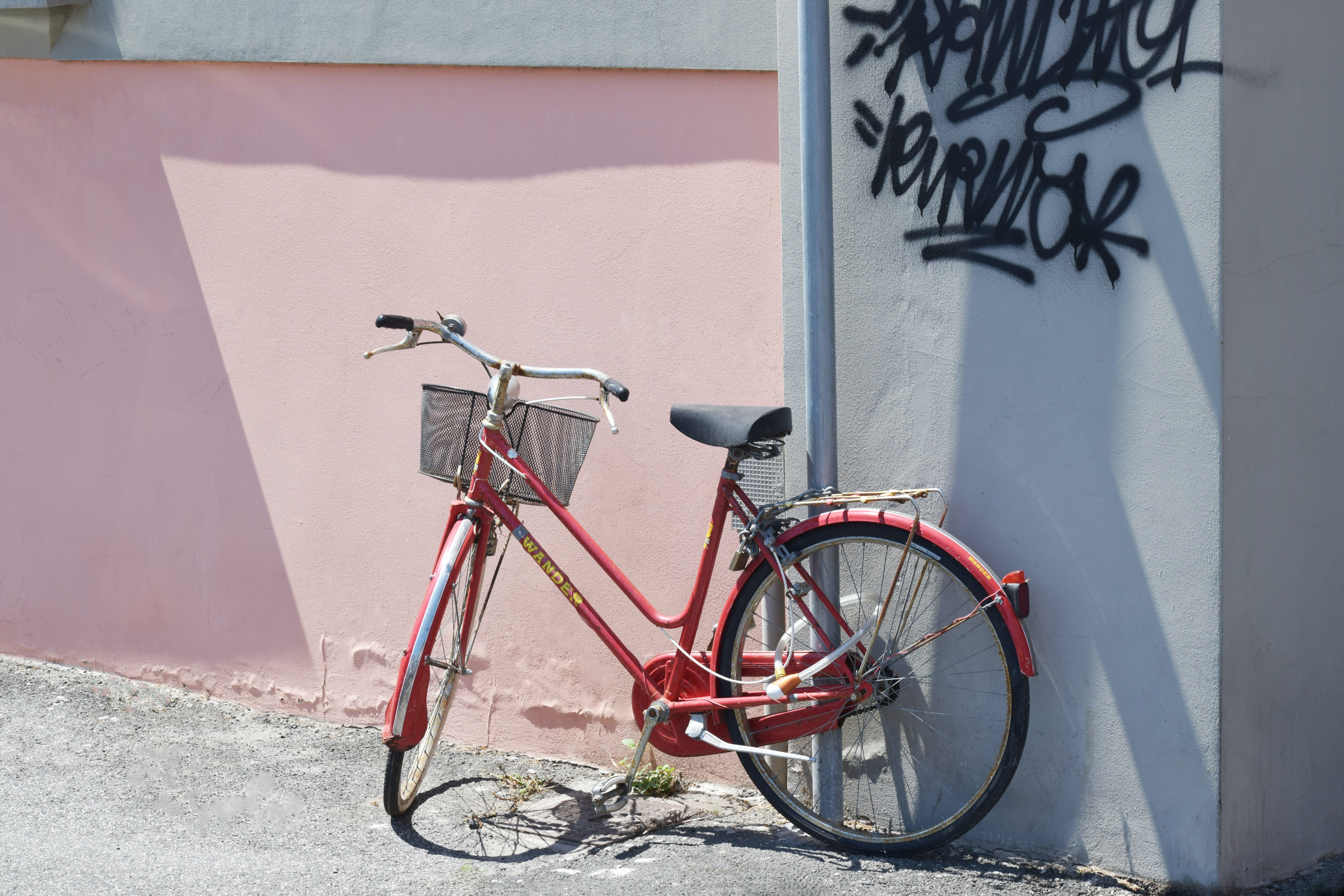 red commuter bike on road