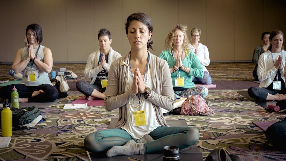 group of people doing yoga