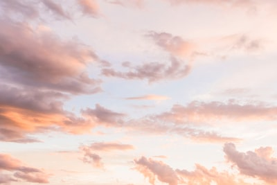 white cloud formations pastel teams background