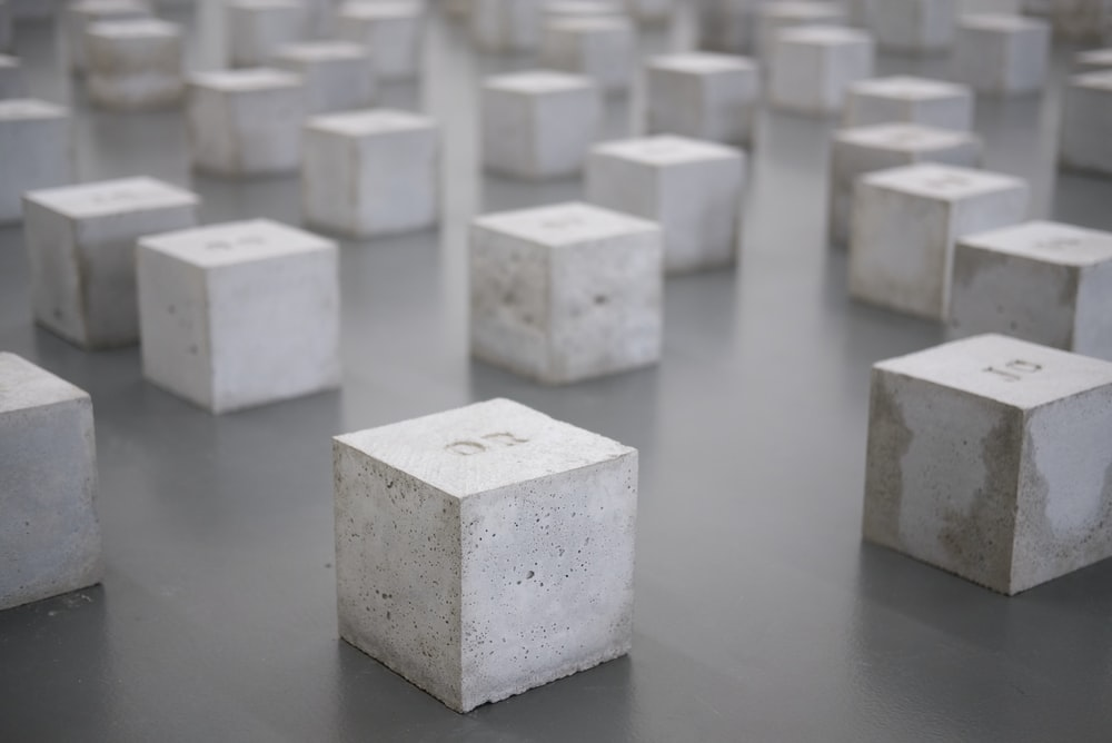 cube white block lot on gray surface