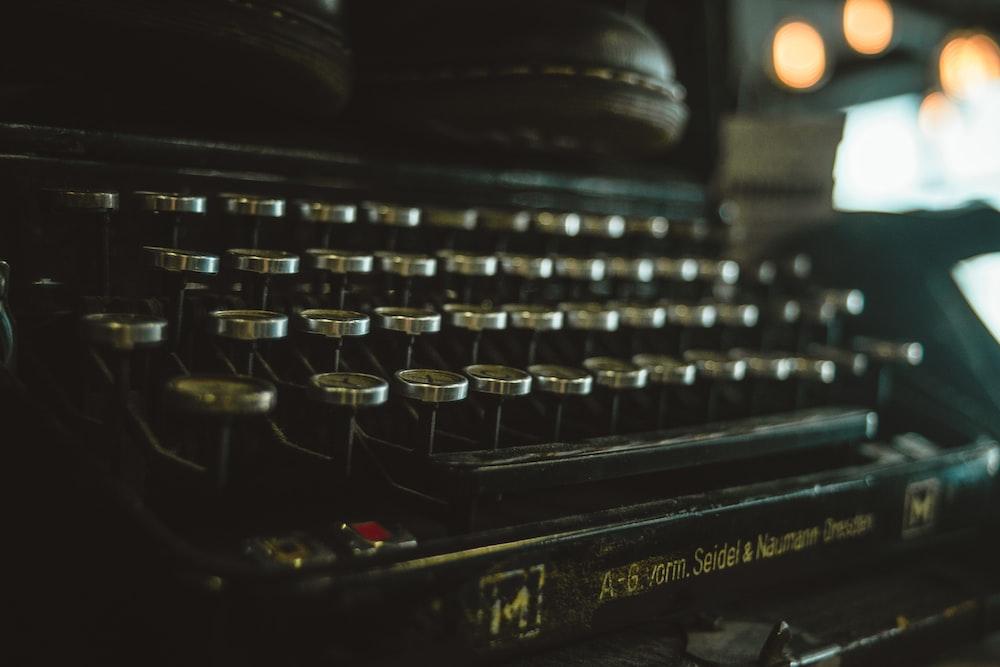 green and black typewriter