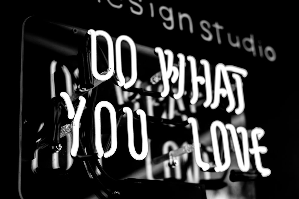 greyscale photo of DO What YOu Love signage