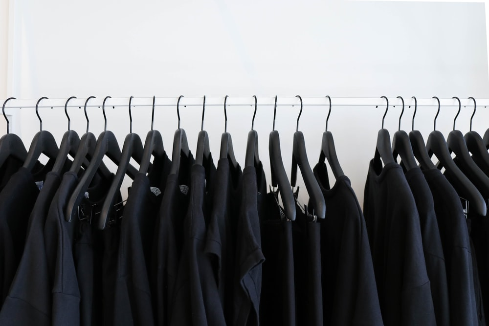 black clothes hanged in rack