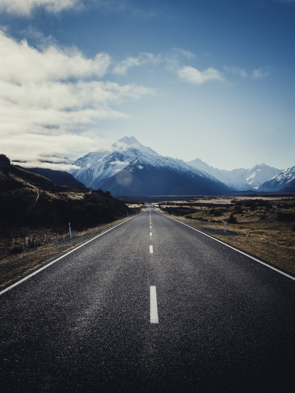 road near mountain during daytime