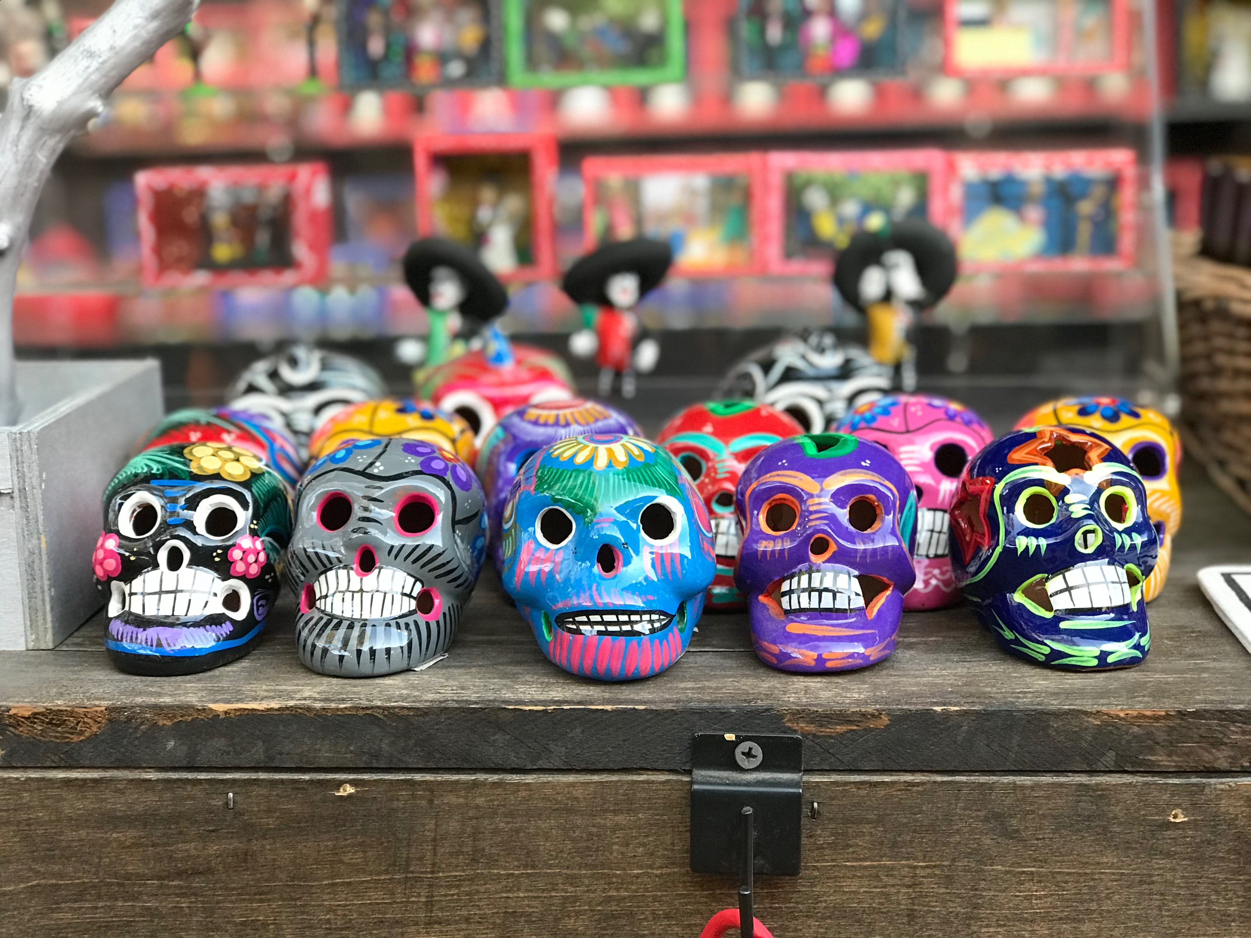 multi-colored sugar skull figurines
